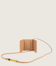 Load image into Gallery viewer, The Triptych mini wallet bag in nude is made from Italian smooth calf leather. The strap comes with a horn element. This compact format is perfect to fit cards, as well as bills and coins. Familiar done differently.
