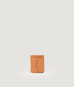 The Triptych mini wallet in camel tone is made from Italian smooth calf leather. This compact format is perfect to fit cards, as well as bills and coins. Familiar done differently.