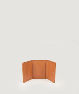 The Triptych mini wallet in Nude is made from Italian smooth calf leather. This compact format is perfect to fit cards, as well as bills and coins. Familiar done differently.