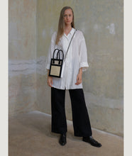 Load image into Gallery viewer, Vienna Shopper Tote bag, size S in tricolor beige, white, silver, black. Wiener Geflecht framed with Italian calf leather. Long removable shoulder strap with signature hand knotted shoulder handle. Exquisite signature style.