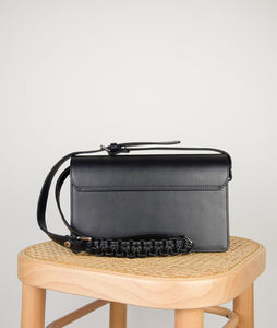 The Vienna crossbody bag, size M in black from Italian calf leather. Long adjustable shoulder strap with signature hand knotted leather shoulder handle. This style is designed to fit all your essentials.