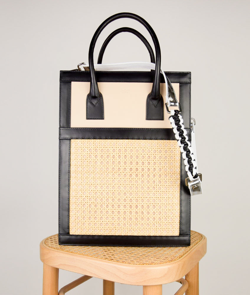 Vienna Shopper Tote bag in tricolor black, beige, white, silver. Wiener Geflecht framed with Italian calf leather. Magnet fastening on outside pocket, two magnet fastening for closing on the top. Long removable shoulder strap with signature hand knotted shoulder handle. Additionally short handle.