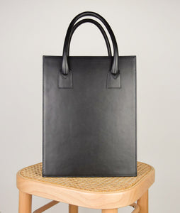 Vienna Shopper Tote bag in color black. Wiener Geflecht framed with Italian calf leather.  Long removable shoulder strap with signature hand knotted shoulder handle. Additionally short handle. Exquisite signature style.