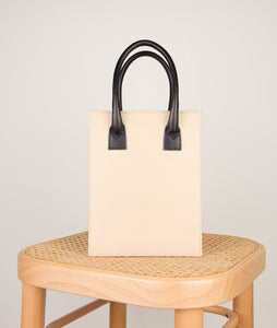 Vienna Shopper Tote bag, size S in tricolor beige, white, silver, black. Wiener Geflecht framed with Italian calf leather. Long removable shoulder strap with signature hand knotted shoulder handle. Exquisite signature style.