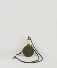 Load image into Gallery viewer, beautiful coin holder necklace in oliv green, compact format for small essentials like cards, bills and coins, made from smooth Italian calf leather, unique accentuated triangle element made from cow horn.