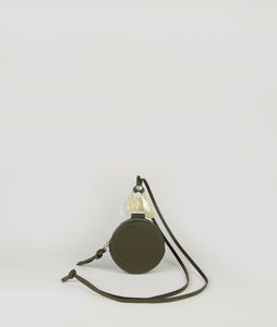 beautiful coin holder necklace in oliv green, compact format for small essentials like cards, bills and coins, made from smooth Italian calf leather, unique accentuated triangle element made from cow horn.