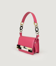 Load image into Gallery viewer, Crossbody bag fuchsia, size S, smooth Italian calf leather with short shoulder strap and an adaptable shoulder strap. The unique front detail and strap details are hand made from cow horn.