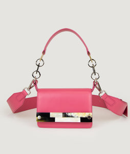 Crossbody bag fuchsia, size S, smooth Italian calf leather with short shoulder strap and an adaptable shoulder strap. The unique front detail and strap details are hand made from cow horn.