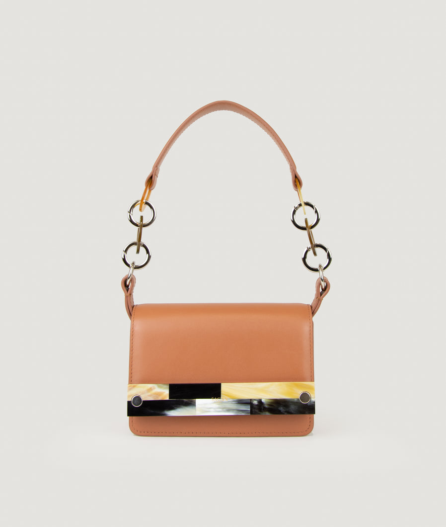 Crossbody bag Miele with mosaic horn, size S, is made from Italian smooth calf leather. It comes with an extra adjustable strap.