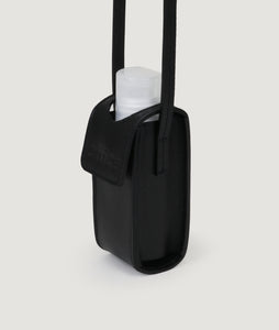 SAGAN Vienna x OFFICE with KOEKKOEK - small hand sanitizer bag in black. With every purchase you are supporting Kayayei girls and women who are affected by the COVID-19 outbreak.