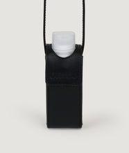 Load image into Gallery viewer, SAGAN Vienna x OFFICE with KOEKKOEK - small hand sanitizer bag in black. With every purchase you are supporting Kayayei girls and women who are affected by the COVID-19 outbreak.