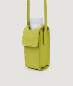 SAGAN Vienna x OFFICE with KOEKKOEK - small hand sanitizer bag in yellow. With every purchase you are supporting Kayayei girls and women who are affected by the COVID-19 outbreak.