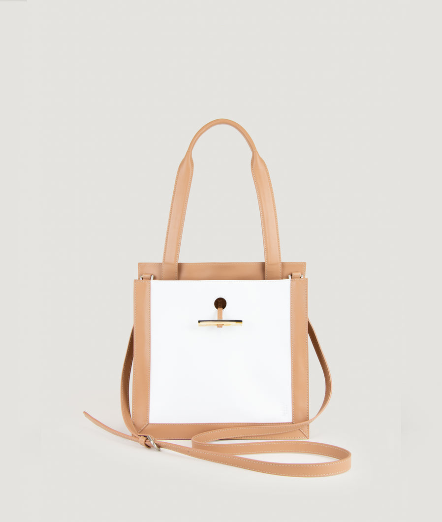 SAGAN Vienna - Shopper bag from Italian smooth calf leather inspired by the scarf shape. Handmade cow horn detail functioning for fastening. Inner zip pocket. Cotton lining.