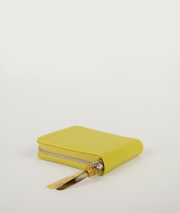 Wallet Square purse in fresh yellow, made from smooth Italian calf leather. It´s generously proportioned to fit all cards, bills and coins. One side zip fastening along the top and sides with accentuated signature puller made from cow horn.