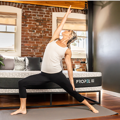 women stretching in front of propel bed