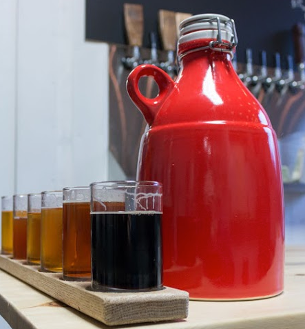 Red Ceramic Growler with a flight of Beer