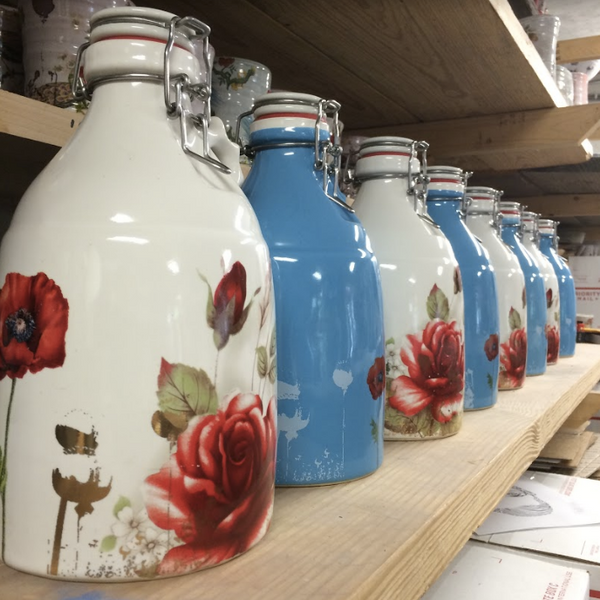 Justin Rothshank's Ceramic Poppy Growlers - a collaboration with Portland Growler Company.