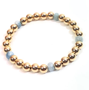 6mm 14kt Gold Filled Bead Bracelet with 5 6mm Oval Aquamarine Beads