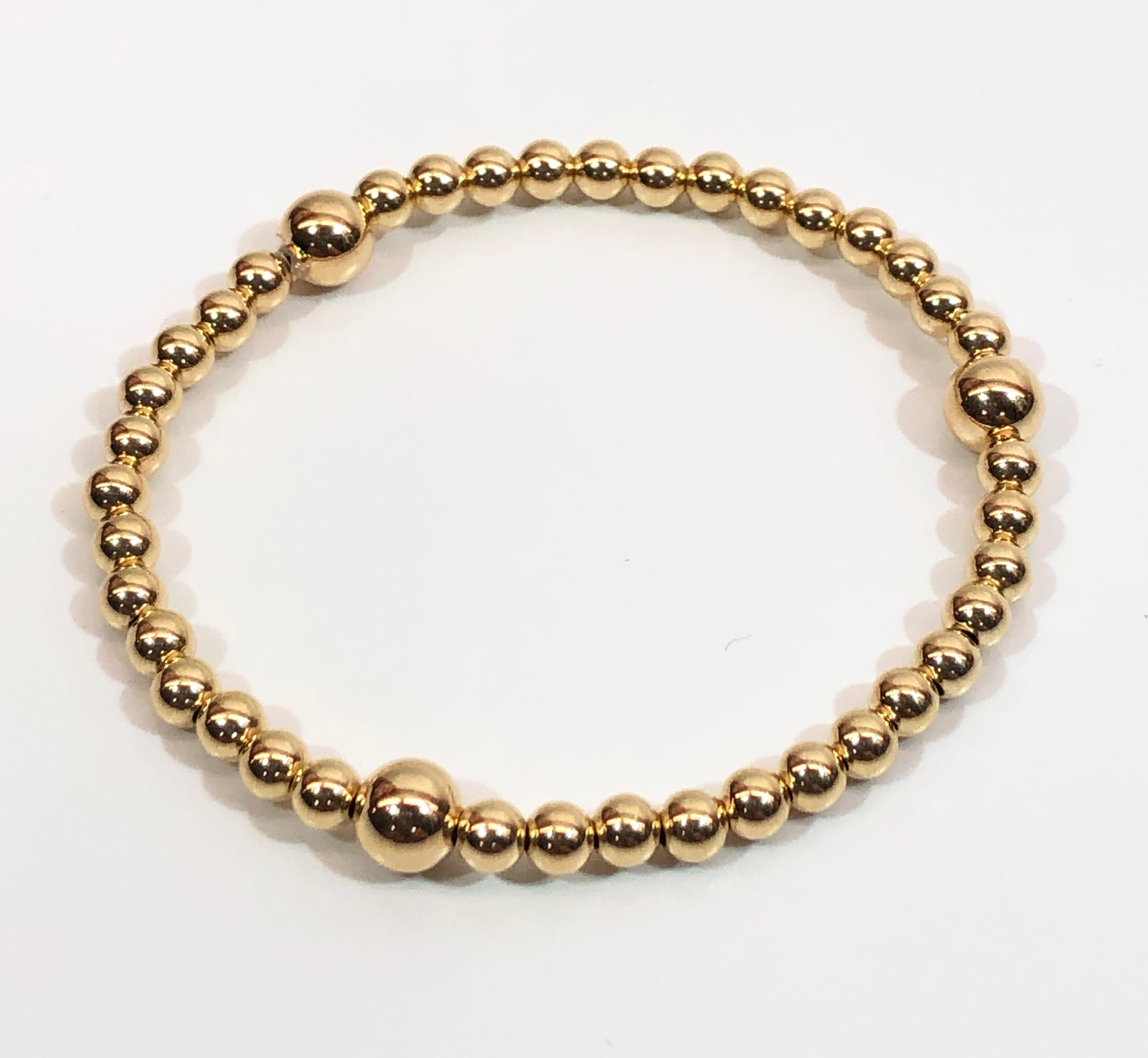 4mm 14kt Gold Filled Bead Bracelet with 3 6mm Gold Beads