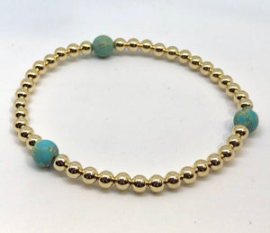 4mm 14kt Gold Filled Bead Bracelet with 3 6mm Turquoise Beads