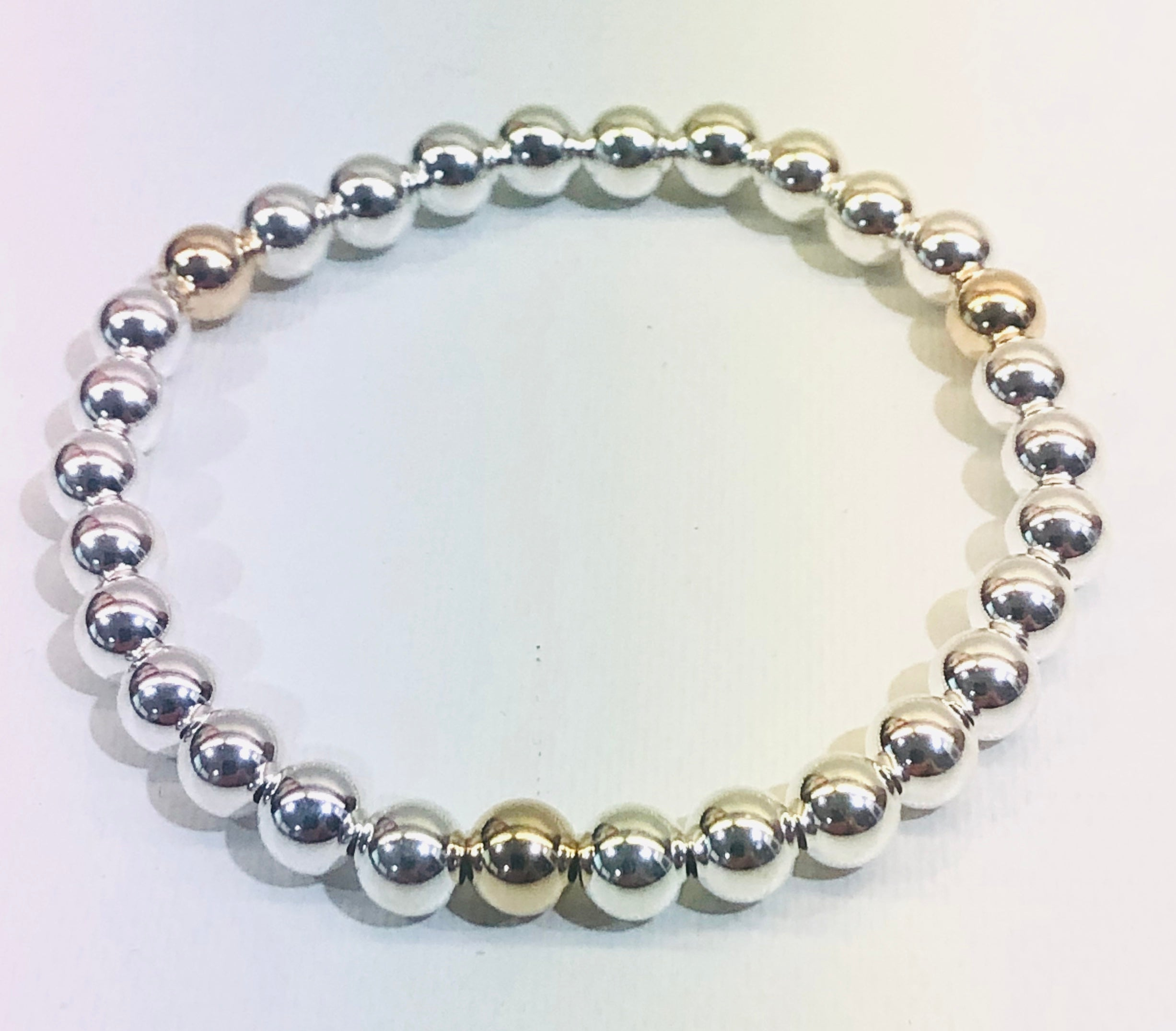 6mm Sterling Silver Bracelet with 3 6mm 14kt Gold Filled Beads