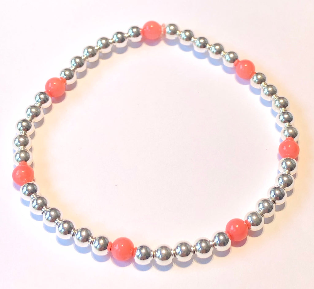 4mm Sterling Silver Bead Bracelet with 7 4mm Pink Coral Beads