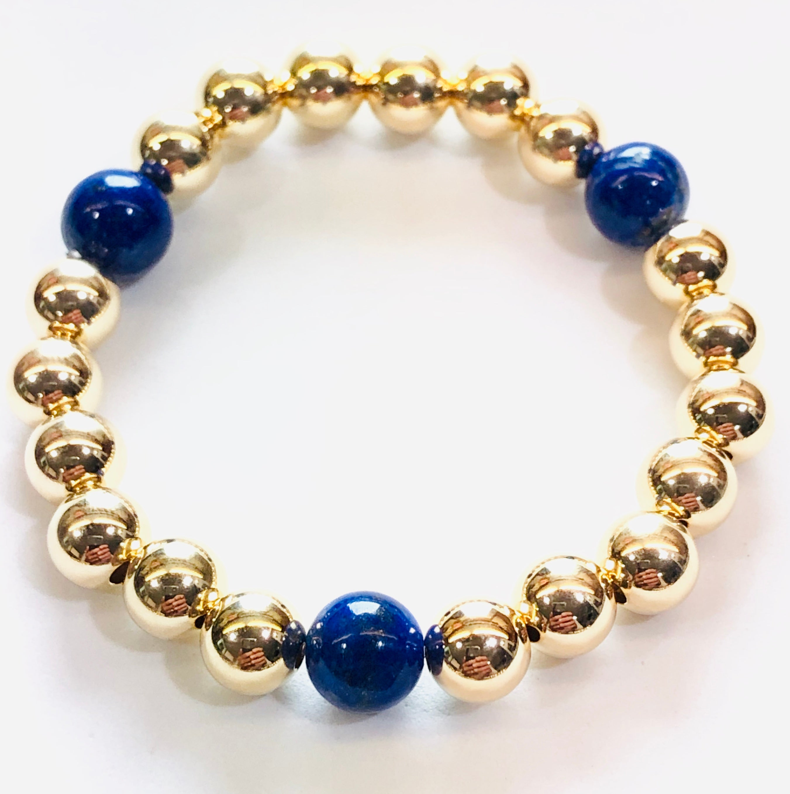 8mm 14kt Gold Filled Bead Bracelet with 3 8mm Blue Lapis Beads