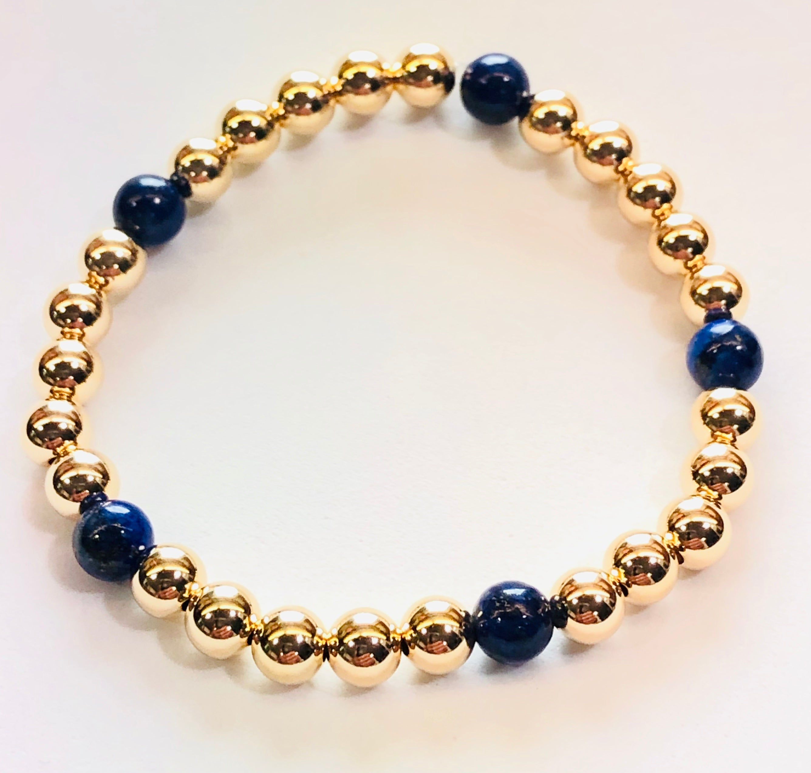 6mm 14kt Gold Filled Bead Bracelet with 5 6mm Blue Lapis Beads