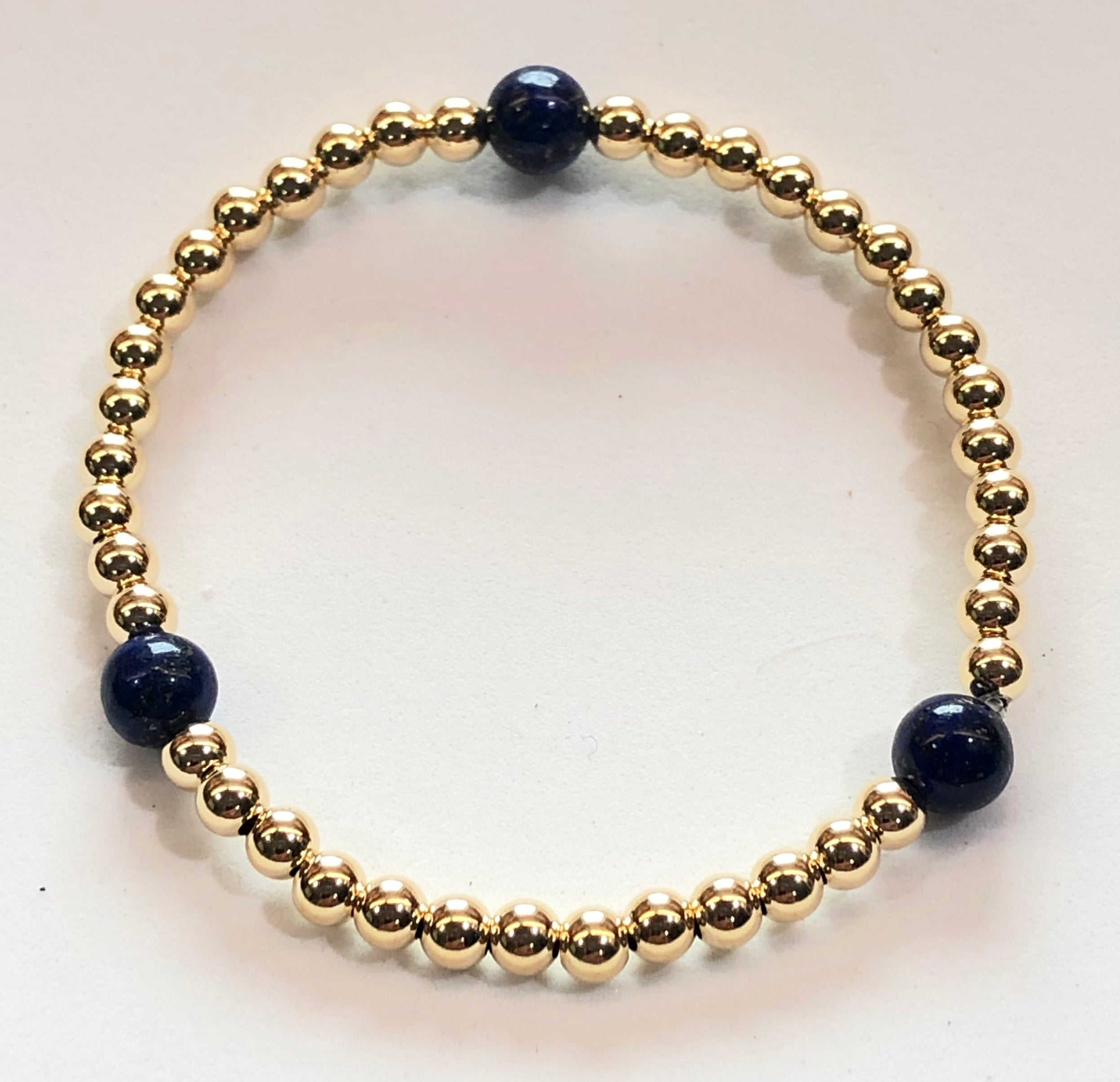 4mm 14kt Gold Filled Bead Bracelet with 3 6mm Blue Lapis Beads