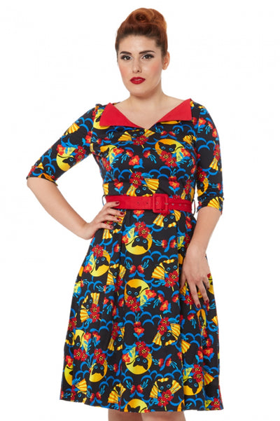 The cutest 50s style dress with red fold over collar giving a high V neck, with the cutest black cat among a colourful, orange, yellow, red, royal blue on a black background, pockets and red belt with a swing dress just below/on knee