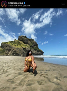 Lizzo wears the Cleopatra Swimsuit in gold while vacationing in New Zealand.