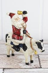 KRIS KRINGLE COW RESIN FIGURINE
