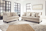 Sala contemporanea, Sofa y loveseat beige con estoperoles