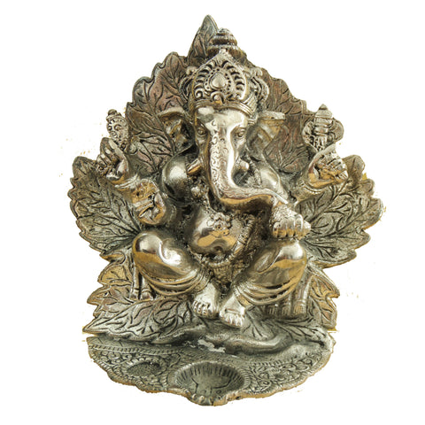 Ganesh Idol  surrounded with Leaves