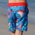 Girl wearing SBB Godzilla & Gang Going Out Boardies back view