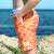 Boy wearing SBB Kids Going Out Boardies recycled Orange Crush side pocket