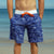 SBB Mens Surfer Boardies from recycled plastic bottles, in Sea Dragon print. Front pockets view