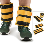 Black and yellow ankle strap weights on male model with green trainers