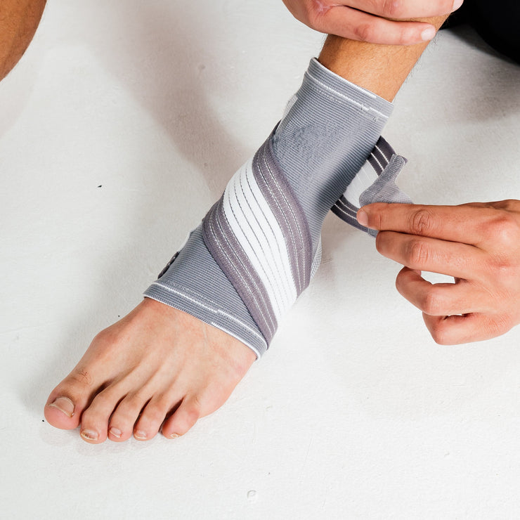 Ankle Support Brace - Compression Bandage with Adjustable Strap