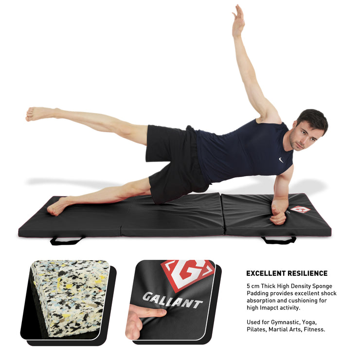 Male model using the black tri-folding mat