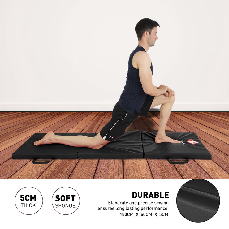 Male model stretching on the black tri-folding mat