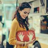 Model red and cream Cykochik custom hand print applique eco-friendly vegan clutch wristlet by Dallas artist Kevin Obregon