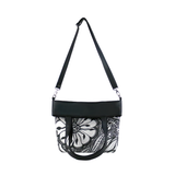 Front folded Black and white Cykochik custom Botanica floral eco-canvas vegan crossbody/tote bag by artist Jody Pham