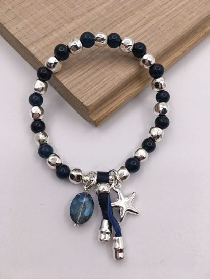 Silver and navy bead stretch bracelet with navy crystal, star and leather charms