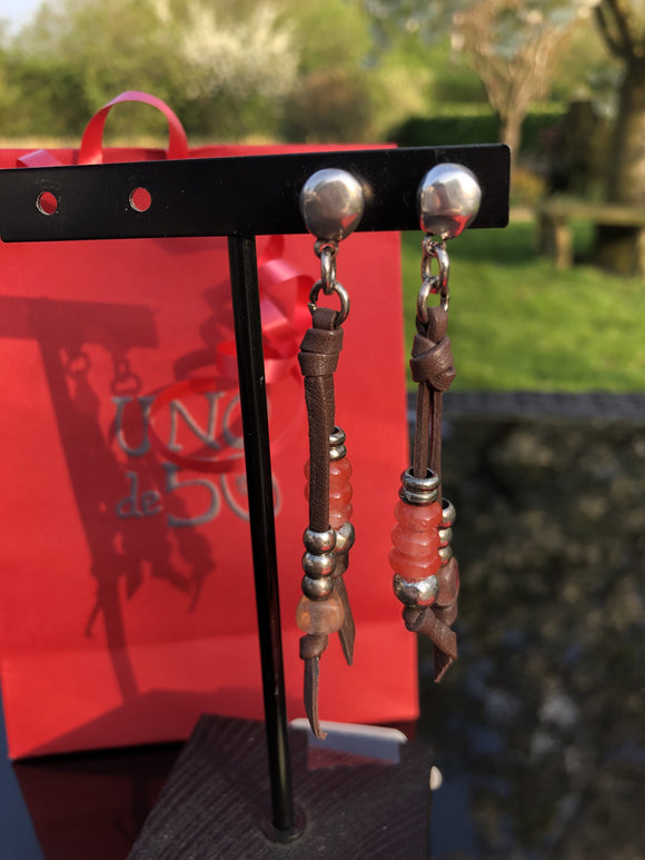 Leather drop earrings with coral stones