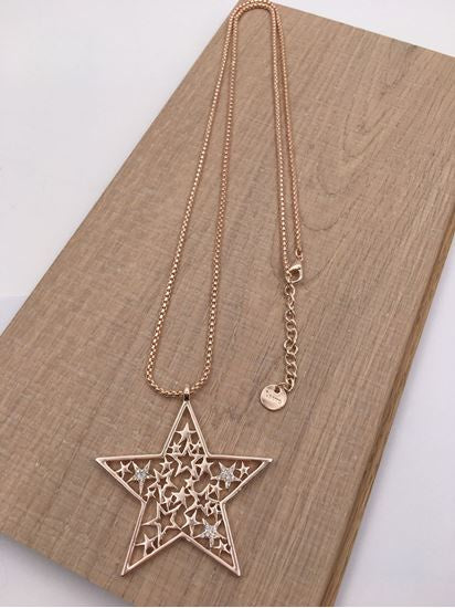Rose gold necklace with large stars in star pendant