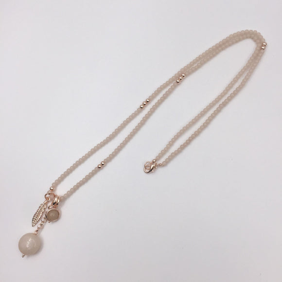 Rose gold nude beaded necklace with feather pendant