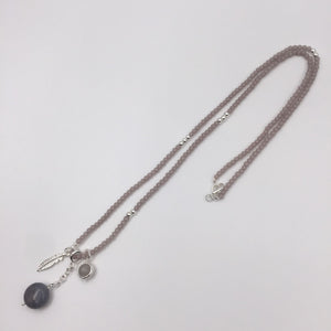 Silver nude beads necklace with silver feather pendant