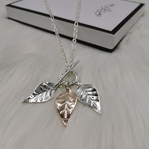 Silver T bar necklace with 3 leaves pendants