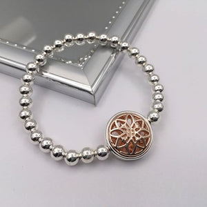 Silver beaded bracelet with rose gold mandala